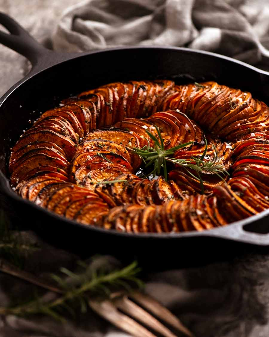 Sweet Potato Bake( side dish) in a black skillet, fresh out of the oven