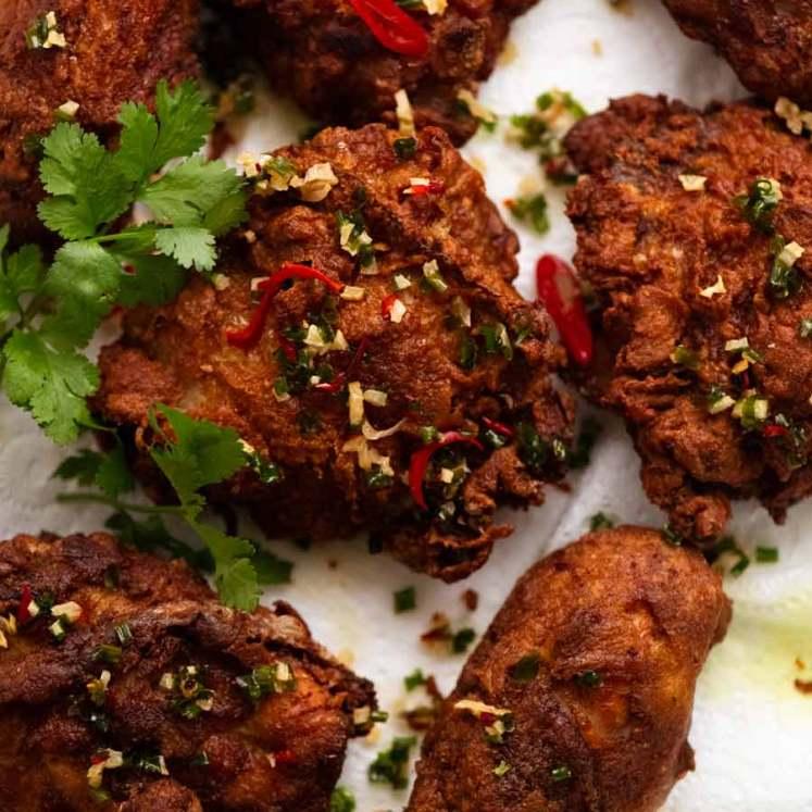 Ayam Goreng (Malaysian Fried Chicken) fresh out of the fryer