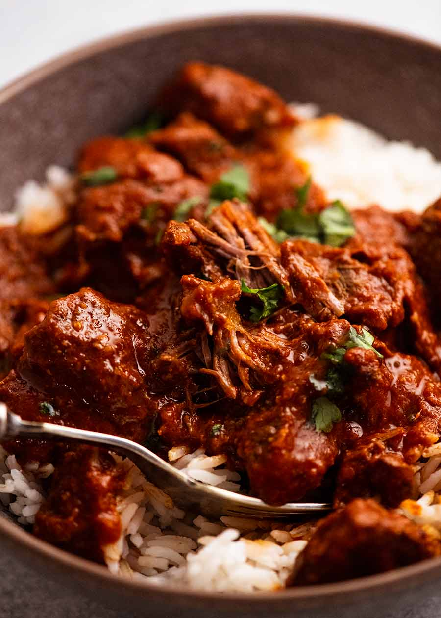Close up of Vindaloo served over rice