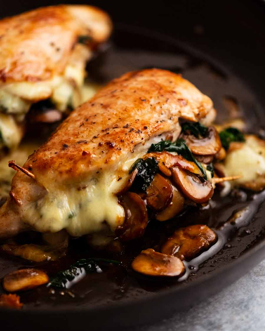 Mushroom Stuffed Chicken Breast in a skillet, fresh out of the oven