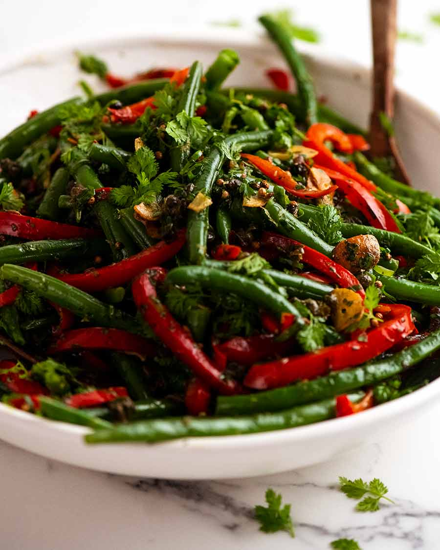 White serving dish with Yotam Ottolenghi's Green Bean Salad