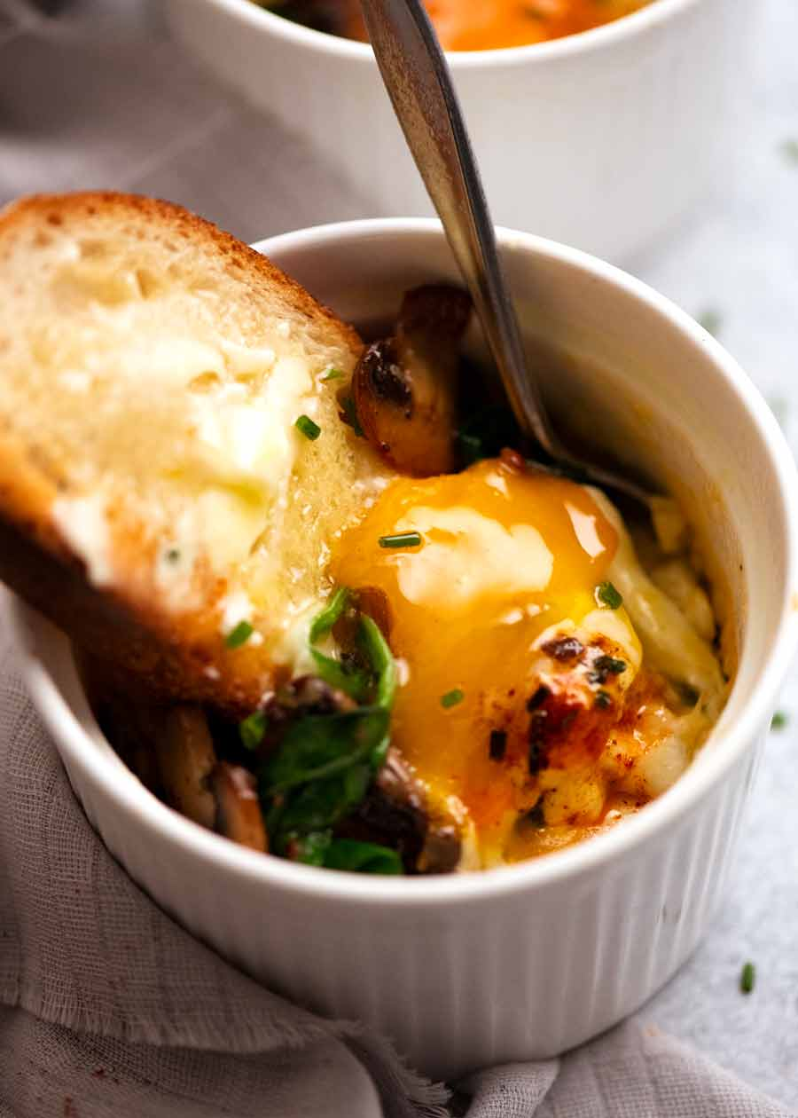 Dunking bread into Baked Eggs - Shirred Eggs