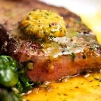 Close up of Cafe de Paris melting on steak