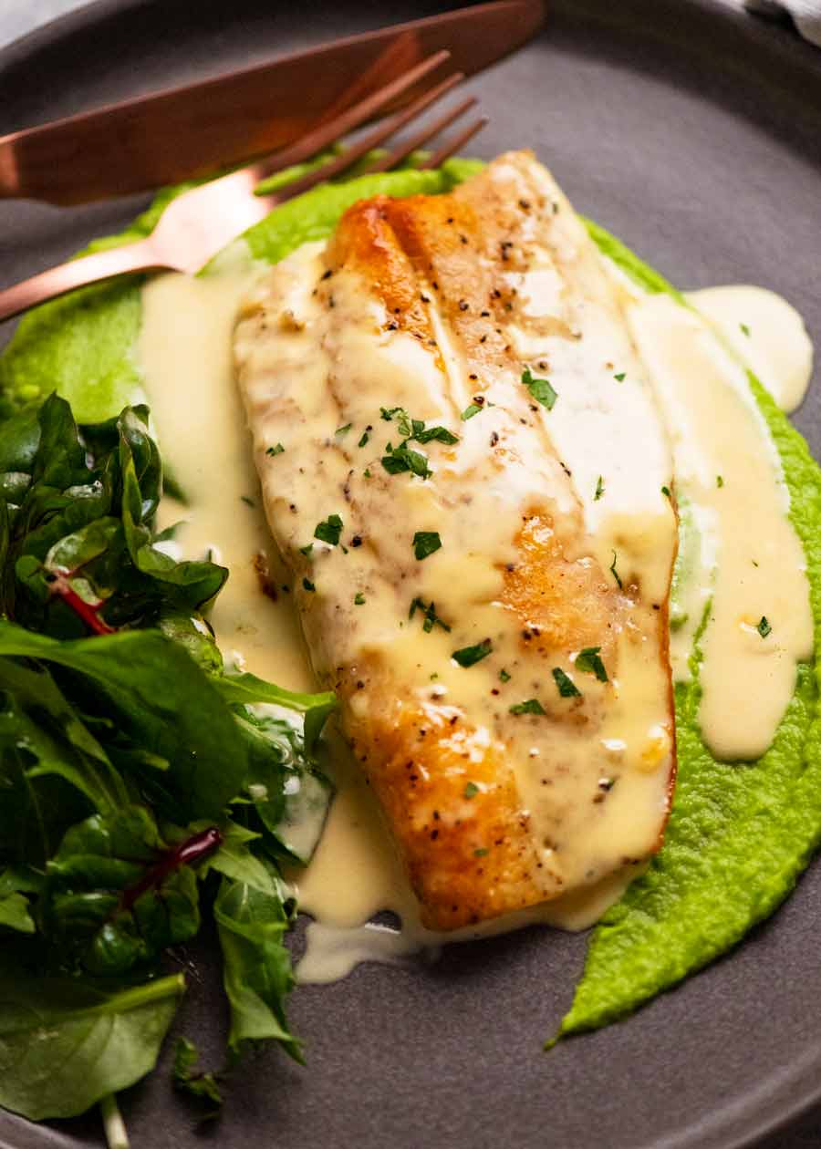 Plate with pan seared snapper on pea puree with white wine sauce