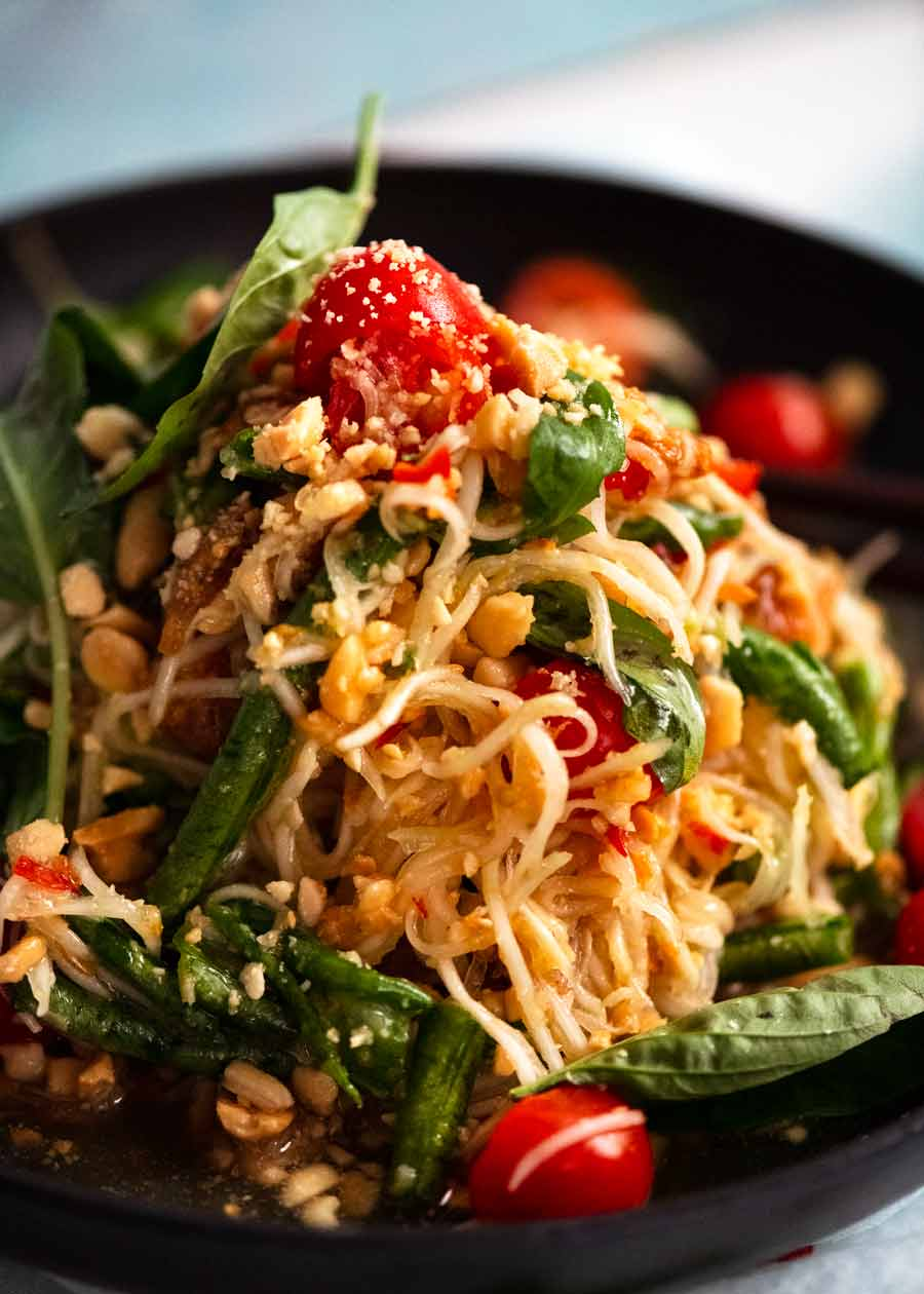 Close up of a pile of Green Papaya Salad (Thai) on a plate