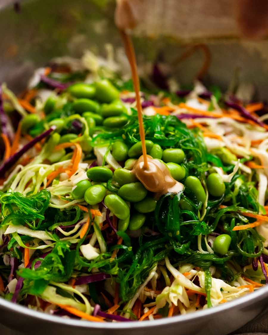 Pouring dressing over Japanese Slaw - Chargrill Charlie's Copycat
