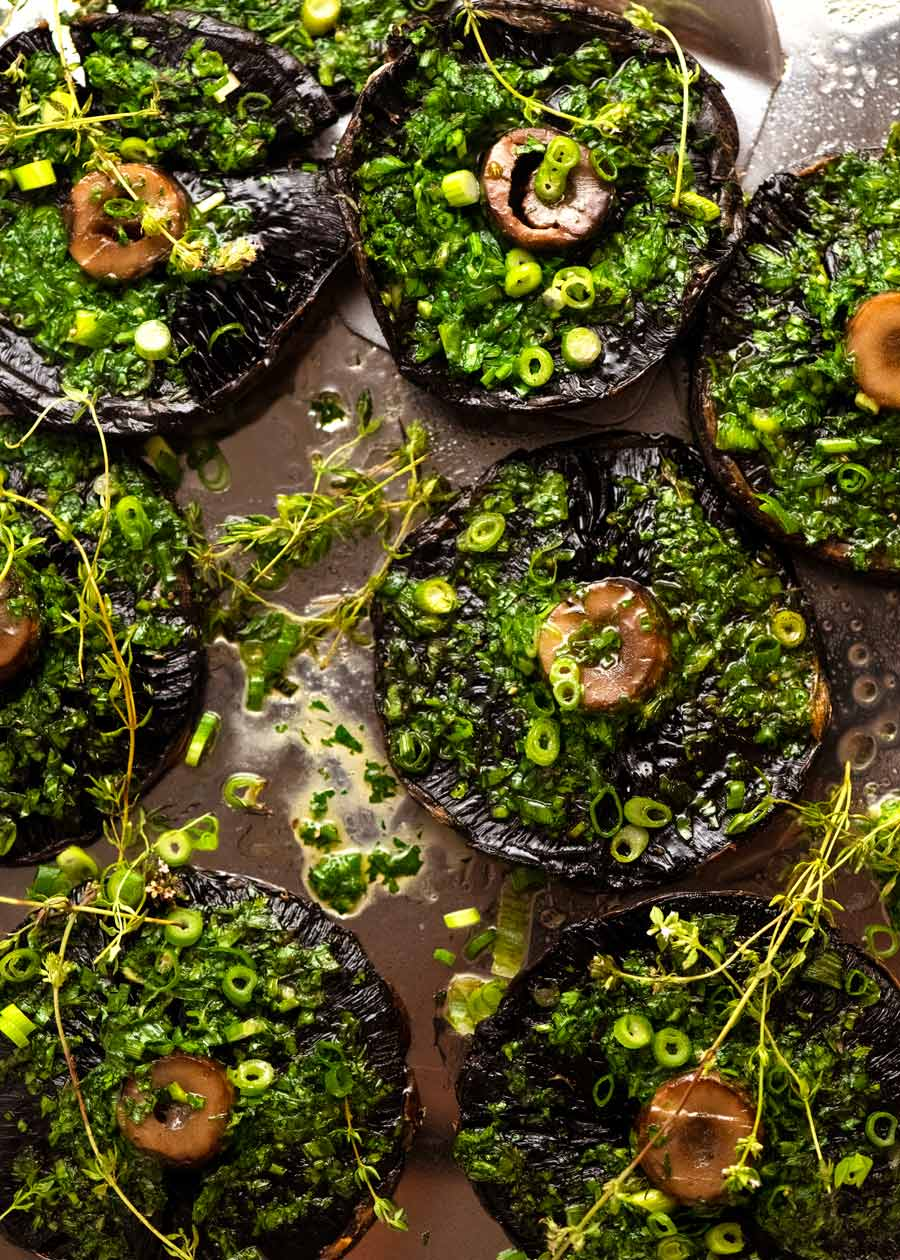 Overhead photo of Roasted Large Mushrooms with Green Onion Thyme Butter on a tray, ready to be served