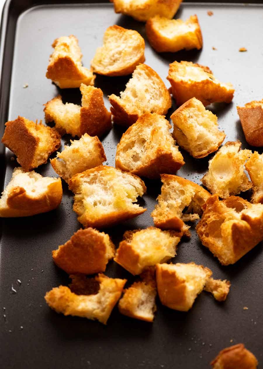 Toasting bread for Panzanella - Italian tomato and bread salad