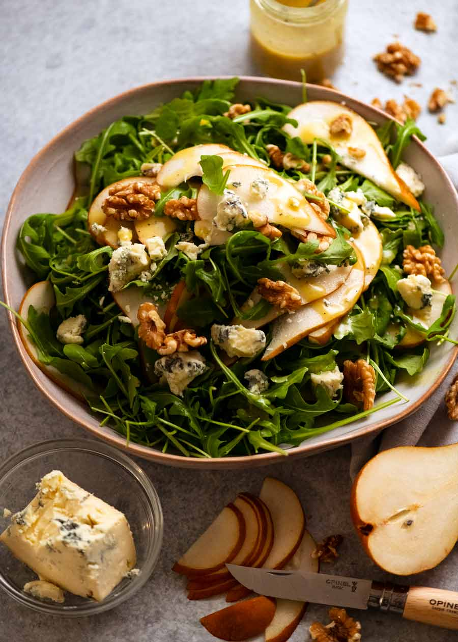 Pear Salad with Blue Cheese and Rocket Arugula in a serving bowl, ready to be eaten