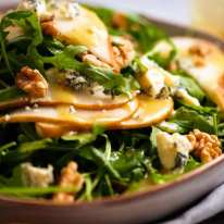 Close up photo of Pear Salad with Blue Cheese and Rocket Arugula
