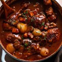 Overhead photo of Coq au Vin - French chicken stew fresh off the stove