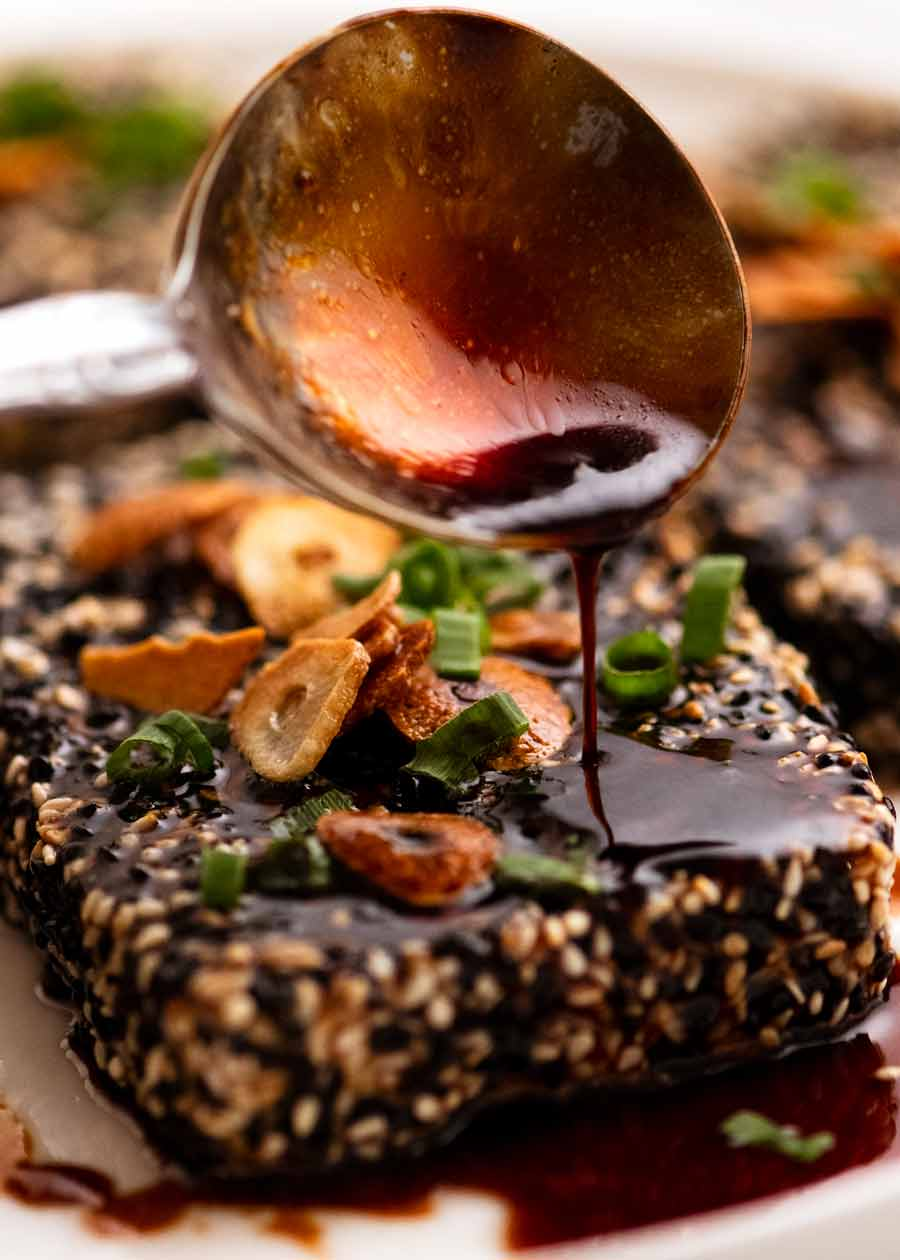 Drizzling Teriyaki Sauce over Sesame crusted Tofu Steaks