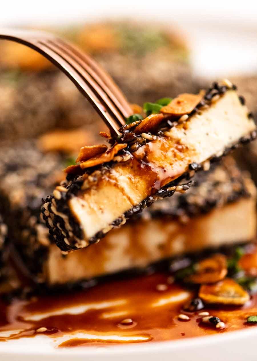 Eating Sesame crusted Tofu Steaks with Teriyaki Sauce