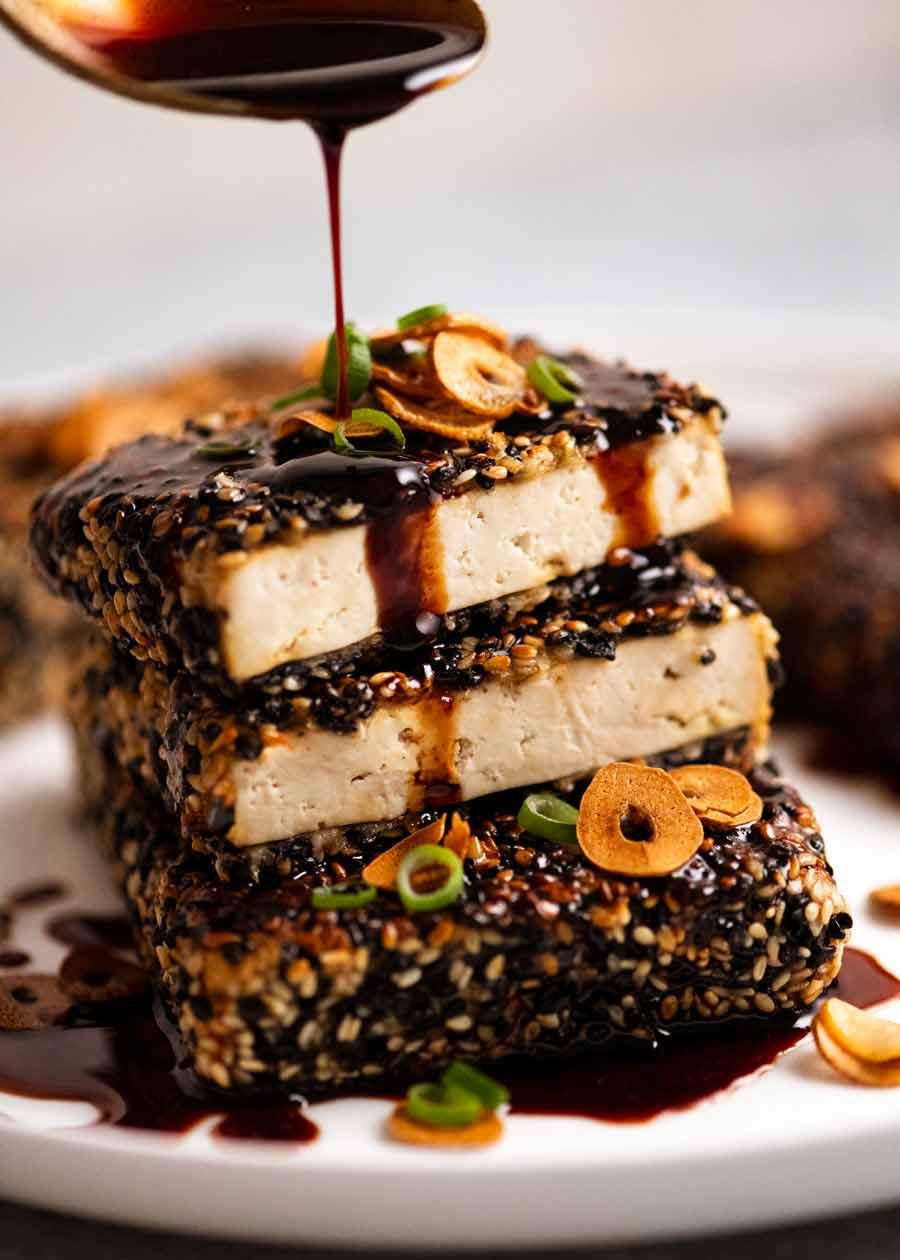 Drizzling Teriyaki Sauce over Sesame crusted Tofu Steaks with Teriyaki Sauce