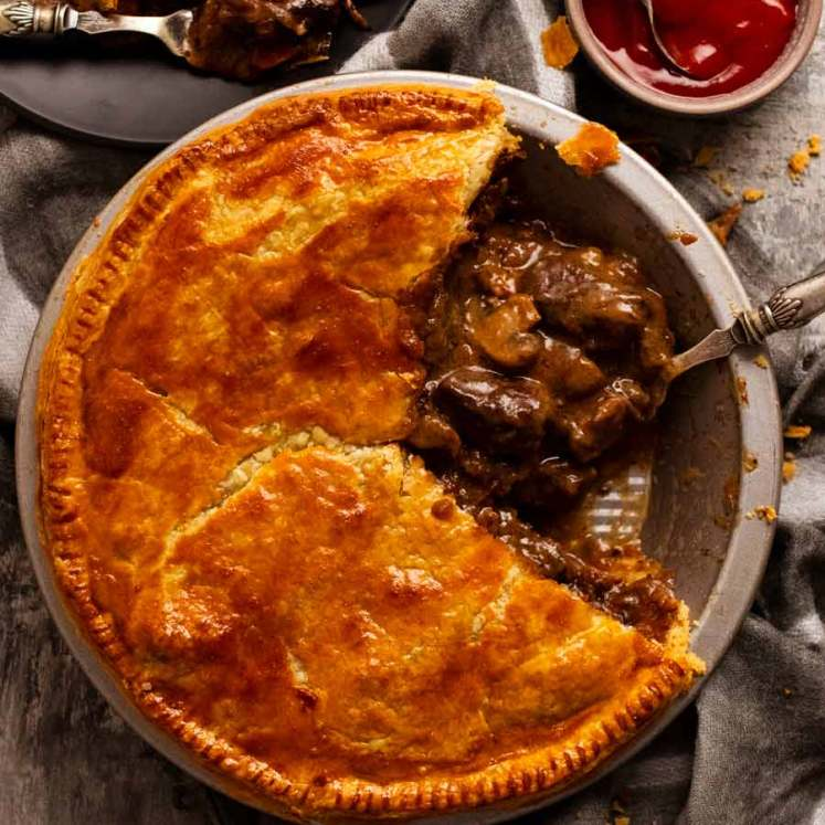 Family Meat Pie with slice taken out of it