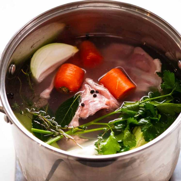 Large pot of Homemade chicken stock being made