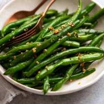 Garlic Sautéed Green Beans on a plate ready to be served
